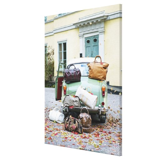 Vintage car with lots of luggage canvas prints