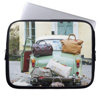 Vintage car with lots of luggage laptop computer sleeve