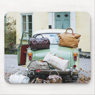 Vintage car with lots of luggage mouse pad