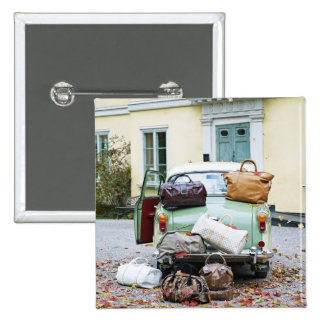 Vintage car with lots of luggage pinback button
