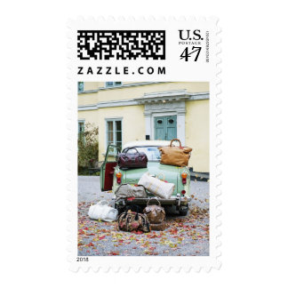Vintage car with lots of luggage postage