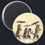 """Vintage Cats Umbrella Snow Magnet<br><div class=""""desc"""">This vintage image has four cats prancing in the snow holding their umbrellas.  They are brown striped felines and the background is a pale mottled yellow with falling snow.  See my store Art by MAR for matching products with this design.</div>"""