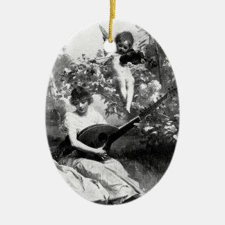 Vintage cherub angel and lady painting ornament