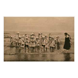 Vintage children paddling in the sea poster
