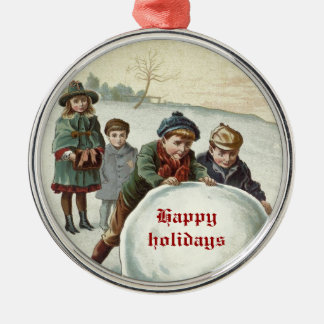 Vintage Children playing in winter Round Metal Christmas Ornament