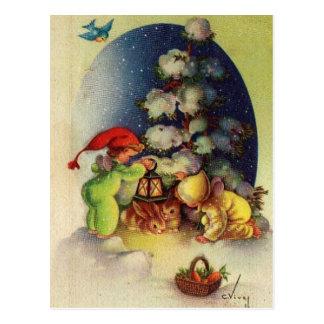 Vintage Christmas Children Feeding Bunnies Postcard