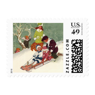 Vintage Christmas, Children Sledding in the Snow Postage Stamp