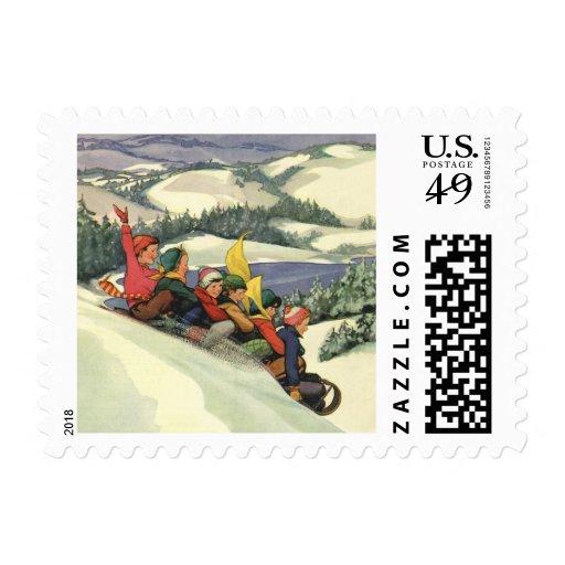 Vintage Christmas, Children Sledding on a Mountain Postage