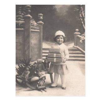 Vintage Christmas postcard-child with gifts Postcard