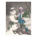 Vintage Christmas postcard-girl with snowman