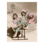 Vintage Christmas postcard-girls on sled