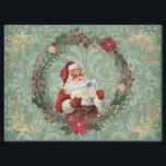 "Vintage Christmas Santa and Wreath Decoupage Tissue Paper<br><div class=""desc"">This Christmas design has a vintage santa inside a poinsettia wreath on top of a light green background with gold elements. Perfect for decoupage art,  gift wrapping,  or paper crafts.</div>"