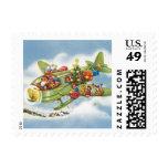 Vintage Christmas, Santa Claus Flying an Airplane Stamp
