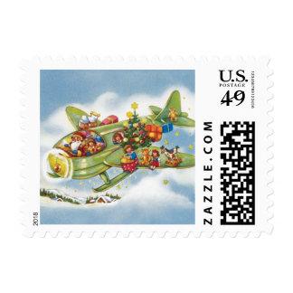 Vintage Christmas, Santa Claus Flying an Airplane Postage