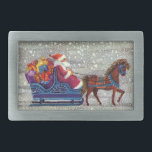 """Vintage Christmas, Santa Claus Horse Open Sleigh Rectangular Belt Buckle<br><div class=""""desc"""">Vintage illustration Victorian Merry Christmas holiday image featuring a jolly Santa Claus riding in a one horse open sleigh on Christmas Eve. It is snowing during the winter with a sleepy town in the distance. White trees covered with their branches covered in snow while snowflakes fall gently from the night...</div>"""