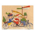 Vintage Christmas, Santa Claus Riding a Bike Postcard