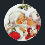 """Vintage Christmas Santa Kissing Mrs Claus Ceramic Ornament<br><div class=""""desc"""">Santa Claus is giving Mrs Claus a kiss under the mistletoe in this sweet vinatge design. A great way to celebrate love this Christmas!</div>"""