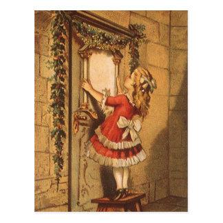 Vintage Christmas Victorian Girl Hanging a Garland Postcard