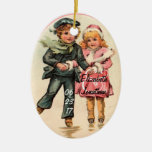 Vintage Couple Ice Skating & Holding Hands Double-Sided Oval Ceramic Christmas Ornament