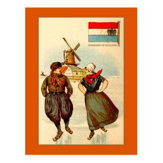 Vintage couple ice skating, windmill, Holland Postcard