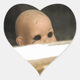 Vintage Dirty Dollhead Peering Out Of Window Heart Sticker