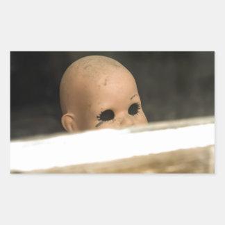 Vintage Dirty Dollhead Peering Out Of Window Rectangular Sticker