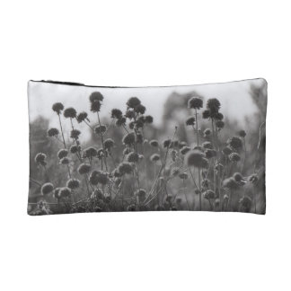Vintage film black and white photograph of flowers makeup bag