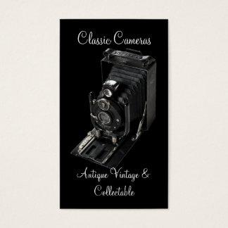 Vintage folding plate camera on black business card
