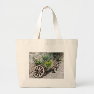 Vintage garden barrow with wild flowers and herbs large tote bag