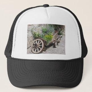 Vintage garden barrow with wild flowers and herbs trucker hat