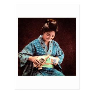 Vintage Geisha Imbibing in a Cup of Sake old Japan Postcard