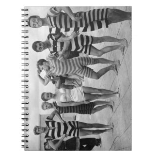 Vintage goofy men in bathing suits with woman notebook