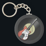"Vintage Guitar Keychain<br><div class=""desc"">Inspired by my 1963 Futurama guitar,  this retro music design is for those that love the music of the 50s &amp; 60s. A nostalgic reminder of the sound of vinyl 45s and rock n&#39; roll music!</div>"