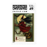 Vintage Halloween Witch Riding a Broom with Cat Postage