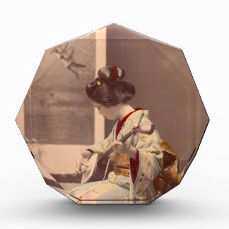 Vintage Japanese geisha playing the shamisen Award