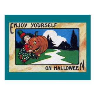 Vintage Kid Hefting Halloween Jack O'Lantern Postcard