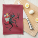"""Vintage Krampus Kitchen Towel<br><div class=""""desc"""">Vintage Krampus catching children.  This nice looking towel features a Krampus gathering up children to take for spankings as they were very naughty this year.  No Christmas for them!</div>"""