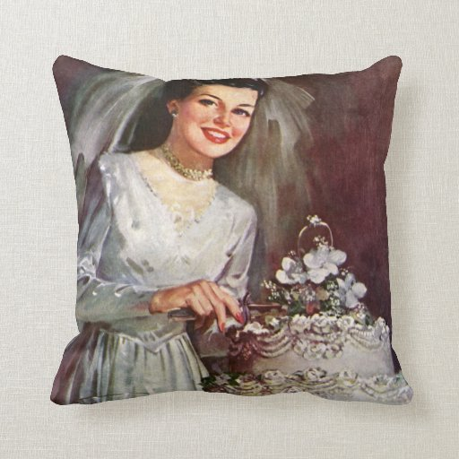 Vintage la novia hermosa y su pastel de bodas cojin