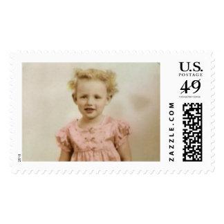 Vintage little girl in pink dress postage stamp