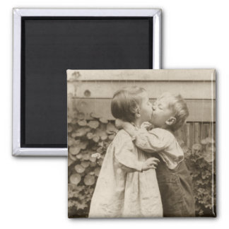 Vintage Love Photo of Children Kissing in a Garden Magnet