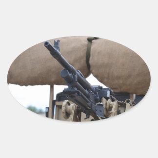 Vintage Machine Gun And Armor Oval Sticker