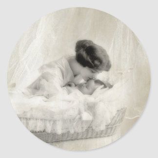 Vintage Mother Kissing Baby in Bassinet Classic Round Sticker