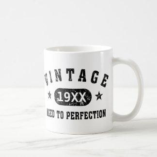 Vintage negro del texto envejecido a la taza de la