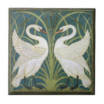 "Vintage Nouveau Swans Ceramic Tile<br><div class=""desc"">This lovely tile features a reproduction of a section of wallpaper by Walter Crane of the English Arts and Craft fine art movement (c 1900). The design depicts 2 white Swans amid pale green rushes on a muted blue background. This art period featured elements of Art Nouveau and Art Deco...</div>"