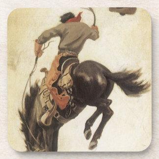 Vintage occidental, vaquero en un caballo Bucking Posavaso