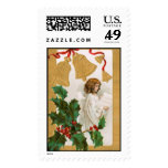 Vintage old fashioned angel with bells and berries postage stamps