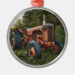 Vintage old red tractor metal ornament