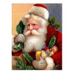 Vintage Papá Noel con los juguetes y las ramitas d Tarjetas Postales