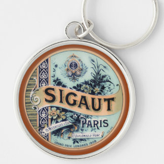 "Vintage Parisian ""Sigaut"" Silver-Colored Round Keychain"