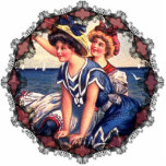 "Vintage Patriotic Swimmers Ornament<br><div class=""desc"">At the beach on a beautiful Fourth of July summer day in the early 1900s,  these two patriotic swimmers out on a rock in the ocean,  patriotically wave the American flag to the regatta sailing behind. Reprinted on this Christmas ornament for those dreaming of the beach!</div>"